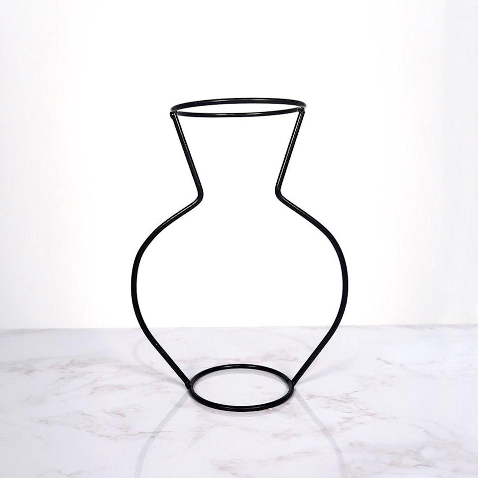 """You can't get more quintessentially outline vase than this. Silhouette Vases has a range of styles and colours, though the black take on a flower vase is the most popular.<br><br><strong>Silhouette Vases</strong> Silhouette Vase™️, $, available at <a href=""""https://silhouettevases.com/products/brand-new-style-retro-iron-line-flowers-vase-metal-plant-holder-modern-solid-home-decor-nordic-styles-iron-vase?variant=37816914346172"""" rel=""""nofollow noopener"""" target=""""_blank"""" data-ylk=""""slk:Silhouette Vases"""" class=""""link rapid-noclick-resp"""">Silhouette Vases</a>"""