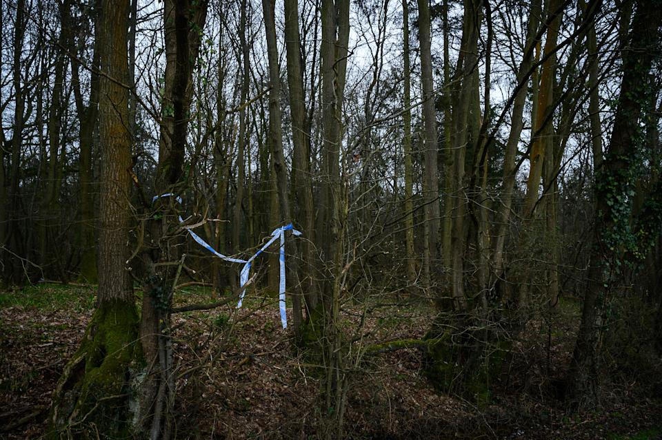ASHFORD, ENGLAND - MARCH 10: Police tape is seen at one of the search sites near to a disused paintball centre on Bears Lane, near Great Chart Golf and Leisure during an investigation into the disappearance of a woman, Sarah Everard, last week in South London, on March 10, 2021 in Ashford, England. The police have confirmed that human remains have been found in woodland nearby. A Metropolitan police officer has been arrested in connection with the case. Ms Everard, 33, from Brixton, London, has been missing since leaving a friend's home in Clapham on Wednesday, March 3. She was last seen at about 21.30 GMT, wearing a green rain jacket, navy blue trousers with a white diamond pattern, turquoise and orange trainers, a white beanie hat and possibly wearing green earphones. (Photo by Leon Neal/Getty Images) (Photo by Leon Neal/Getty Images)