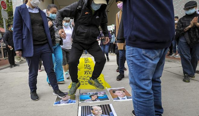 A protester steps on photos of officials to vent his anger. Photo: Dickson Lee