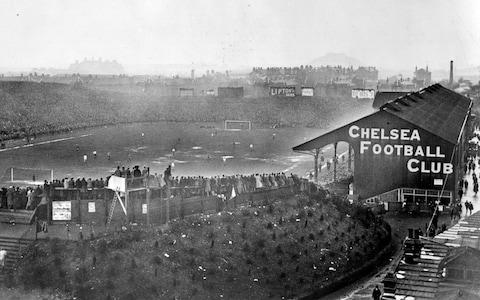 The FA Cup Final in progress between Tottenham Hotspur and Wolverhampton Wanderers at Chelsea's Stamford Bridge ground in 1921 - Credit: Topical Press Agency/Getty Images