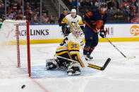 Edmonton Oilers' James Neal (18) misses a shot on Pittsburgh Penguins goaltender Tristan Jarry (35) during the second period of an NHL hockey game Friday, Dec. 20, 2019, in Edmonton, Alberta. (Codie McLachlan/The Canadian Press via AP)