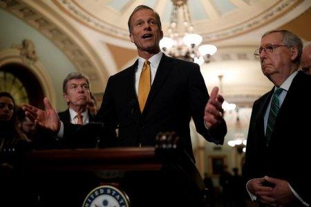 Sen. John Thune (R-SD), accompanied by Senate Majority Leader Mitch McConnell and Sen. Roy Blunt (R-MO), speaks with reporters following the weekly policy luncheons at the U.S. Capitol in Washington, U.S., February 13, 2018. REUTERS/Aaron P. Bernstein