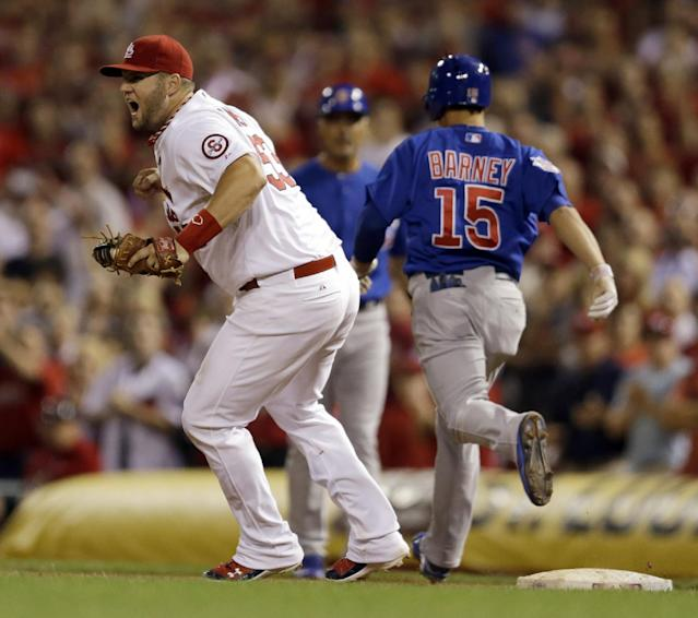 St. Louis Cardinals first baseman Matt Adams celebrates as Chicago Cubs second baseman Darwin Barney grounds out for the final out of the Cardinals' 7-0 win over the Chicago Cubs in a baseball game to clinch the NL Central title Friday, Sept. 27, 2013, in St. Louis. (AP Photo/Jeff Roberson)