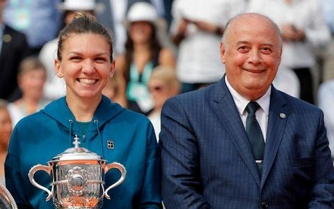 <span>Bernard Giudicelli (right) with the 2018 French Open winner, Simona Halep</span> <span>Credit: Getty Images </span>