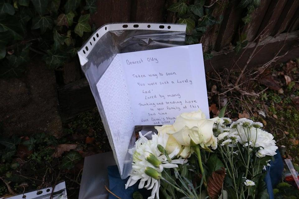 Floral tributes and a card left outside Highdown School in Reading after Olly's murder (PA) (PA Archive)