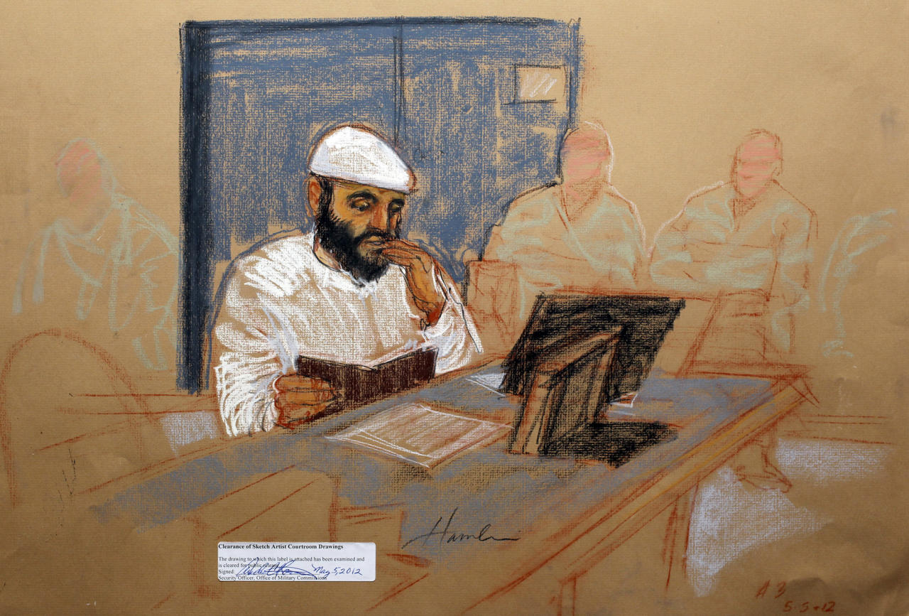 In this photo of a sketch by courtroom artist Janet Hamlin and reviewed by the U.S. Department of Defense, accused Sept. 11 co-conspirator Ramzi Binalshibh is shown while attending his military hearing at the Guantanamo Bay U.S. Naval Base in Cuba, Saturday, May 5, 2012. Khalid Sheikh Mohammed, the self-proclaimed mastermind of the Sept. 11 attacks repeatedly declined to respond to a judge's questions Saturday, and co-defendant Walid bin Attash was briefly restrained at a military hearing as five men, including Binalshibh, charged with the worst terror attack in U.S. history appeared in public for the first time in more than three years. (AP Photo/Janet Hamlin, Pool)