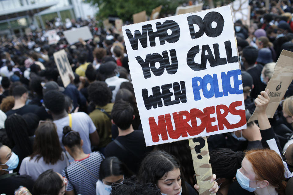 Protesters gather in front of the Paris courthouse, Tuesday, June 2, 2020. Thousands of people defied a police ban and converged on the main Paris courthouse for a demonstration to show solidarity with U.S. protesters and denounce the death of a black man in French police custody. The demonstration was organized to honor Frenchman Adama Traore, who died shortly after his arrest in 2016, and in solidarity with Americans demonstrating against George Floyd's death. (AP Photo/Rafael Yaghobzadeh)