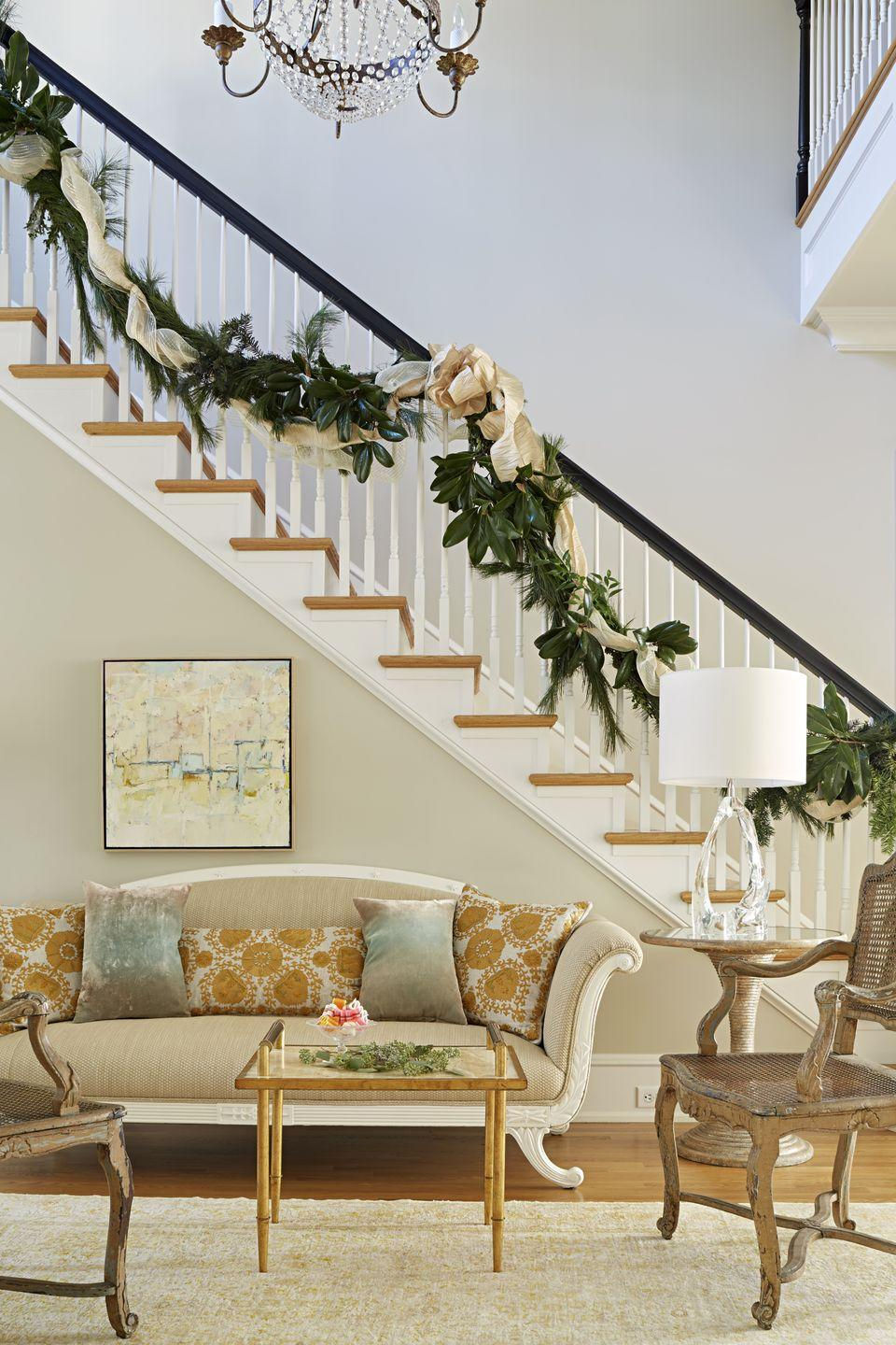 """<p>A honey-colored palette in this design by <a href=""""https://janiemolster.com/"""" rel=""""nofollow noopener"""" target=""""_blank"""" data-ylk=""""slk:Janie Molster"""" class=""""link rapid-noclick-resp"""">Janie Molster</a> is complemented by a natural garland that's weaved with silky ribbon. </p>"""