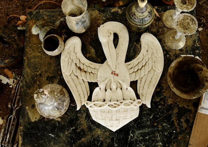 The pelican in her piety seal lays at the alter at the Sacred Heart of Jesus in Creole, Louisiana, on Saturday, Oct. 10, 2020.