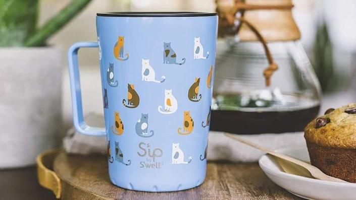 The double-walled mug can keep drinks hot or cold.
