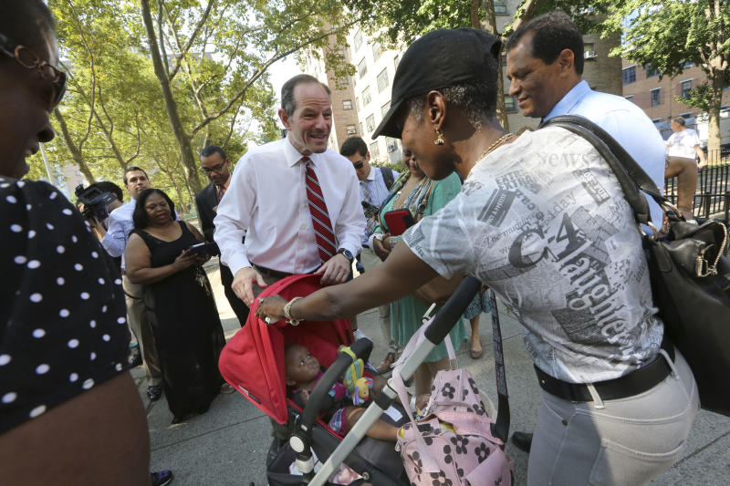 Spitzer unveils policy plans, criticizes opponent