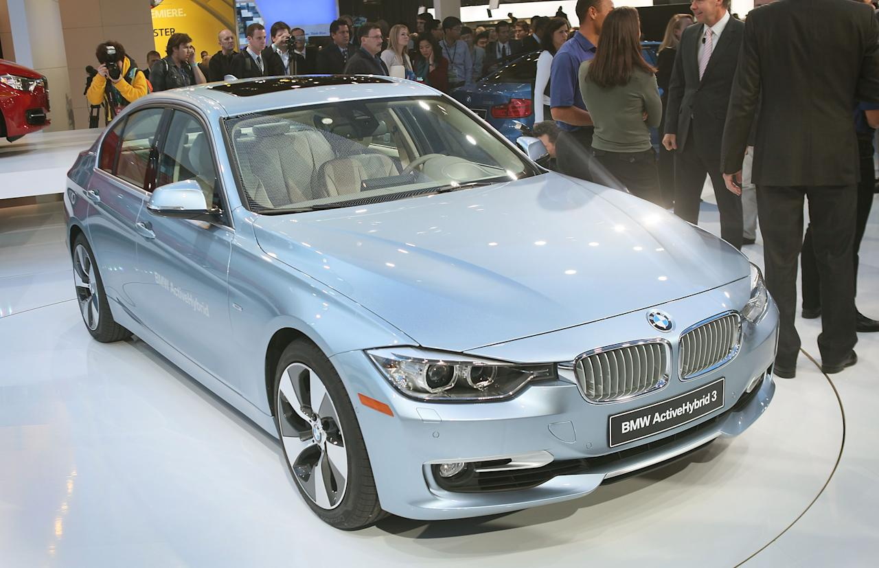DETROIT, MI - JANUARY 09: BMW introduces the new Active Hybrid 3 during the press preview at the North American International Auto Show at the COBO Center on January 9, 2012 in Detroit, Michigan. The show is open to the general public January 14-22. (Photo by Scott Olson/Getty Images)