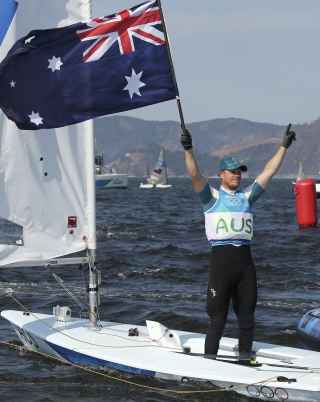 2016 Rio Olympics - Sailing - Preliminary - Men's One Person Dinghy - Laser - Medal Race - Marina de Gloria - Rio de Janeiro, Brazil - 16/08/2016. Tom Burton (AUS) of Australia celebrates winning gold medal. REUTERS/Benoit Tessier FOR EDITORIAL USE ONLY. NOT FOR SALE FOR MARKETING OR ADVERTISING CAMPAIGNS.