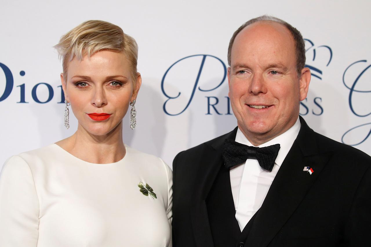 Prince Albert II of Monaco arrives with his wife Princess Charlene of Monaco for the 2016 Princess Grace Awards Gala in the Manhattan borough of New York, New York, U.S., October 24, 2016.   REUTERS/Carlo Allegri