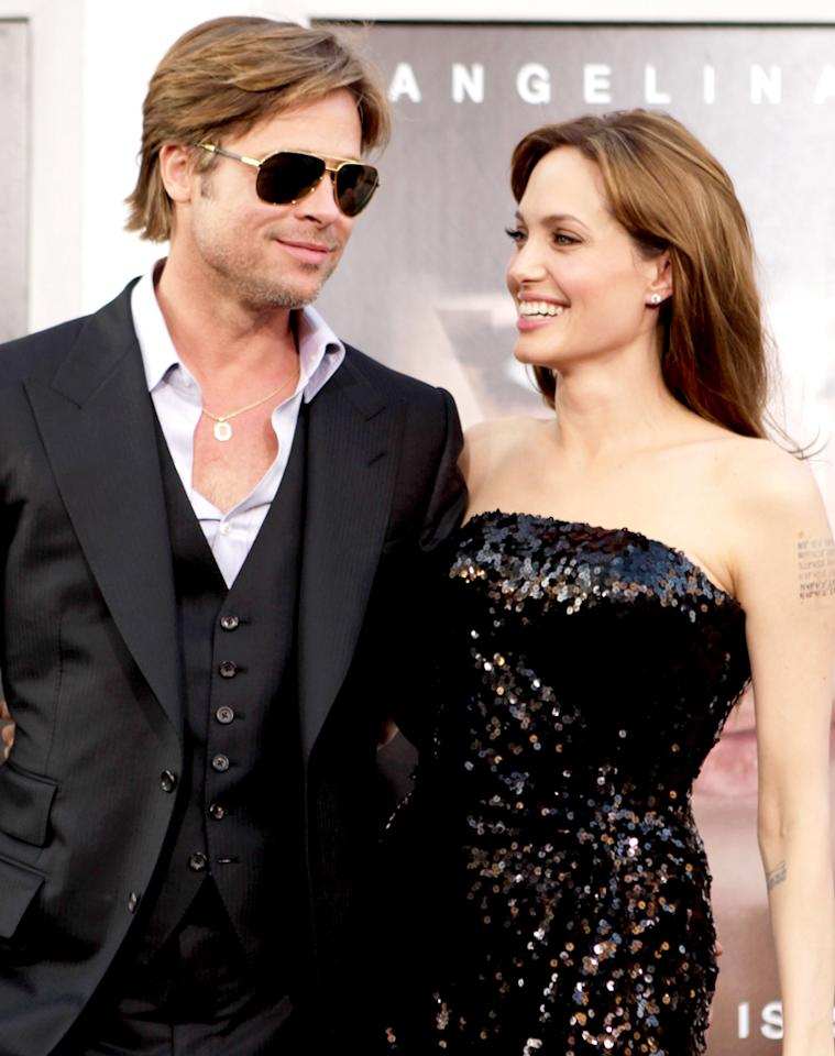 "Brad Pitt and Angelina Jolie got romantic after sharing the screen in ""Mr. & Mrs. Smith."" Jeff Vespa/<a href=""http://wireimage.com"" target=""_blank"">WireImage</a> - July 19, 2010"