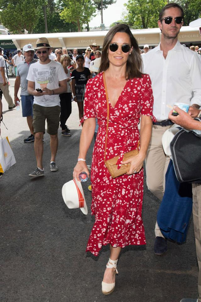 <p>Pippa Middleton wears a brown, woven crossbody bag with a Ralph Lauren wrap dress to attend the French Open. (Photo: Stephane Cardinale/Corbis via Getty Images) </p>