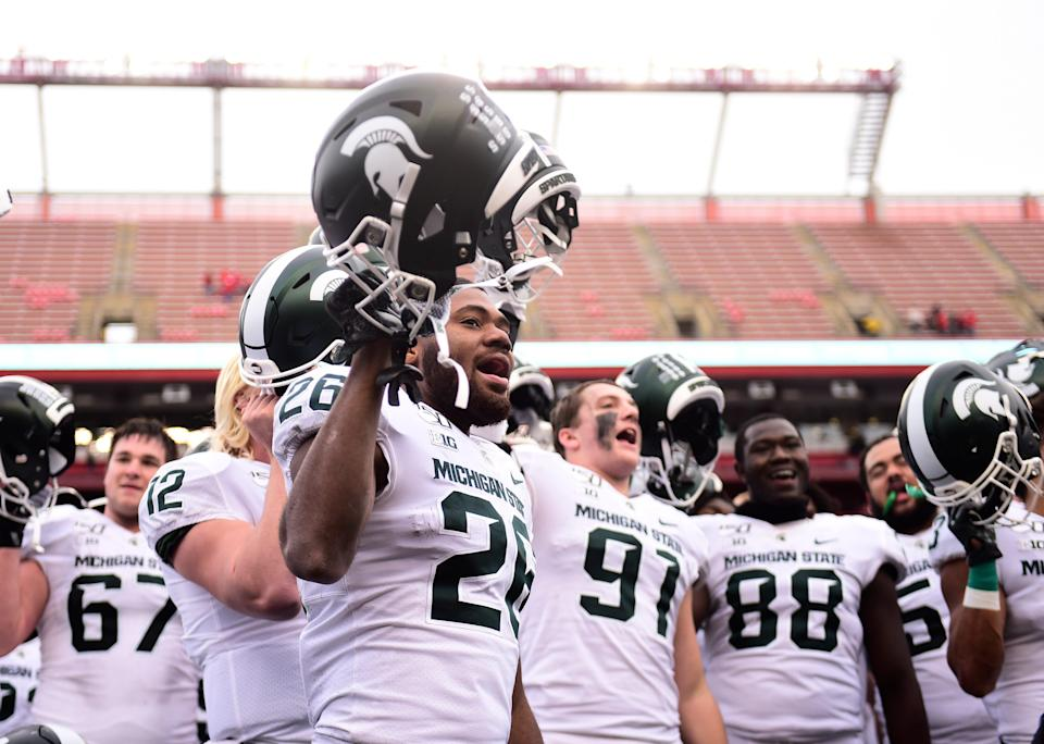 Michigan State's Brandon Wright (26) sings the alma mater after the 27-0 win over Rutgers on Nov. 23, 2019 in Piscataway, New Jersey.