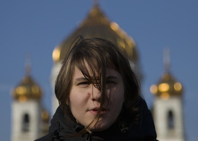 Member of the Pussy Riot punk band Yekaterina Samutsevich,  in front of the Christ the Savior Cathedral, a year after their performance,  in Moscow, Russia, Thursday, Feb. 21, 2013. Yekaterina Samutsevich told the AP on Thursday that she is glad that their punk performance in Christ the Savior Cathedral on Feb. 21, 2012, made Russians more aware of the Orthodox Church's increasingly close ties with the Russian government.  Samutsevich, Maria Alekhina and Nadezhda Tolokonnikova were sentenced to two years in prison for hooliganism motivated by religious hatred, drawing protests around the world about Russia's intolerance of dissent. Samutsevich was later released on appeal.  (AP Photo/Ivan Sekretarev)