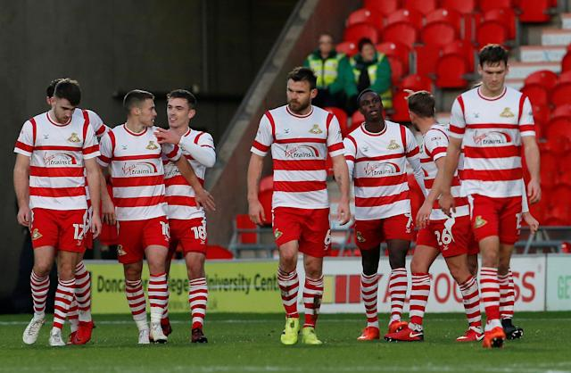 Soccer Football - FA Cup Second Round - Doncaster Rovers vs Scunthorpe United - Keepmoat Stadium, Doncaster, Britain - December 3, 2017 Doncaster Rovers' Tommy Rowe (L) celebrates with team mates after he scores his sides second goal Action Images/Craig Brough