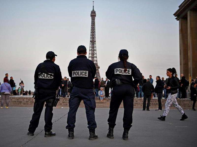 Police in front of the Eiffel Tower in Paris the day after a gunman opened fire on officers on the Champs-Elysees (Getty Images)