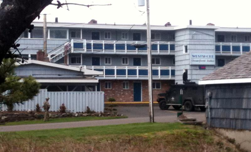 Police vehicles are parked outside of the Westshore Oceanfront Motel, Tuesday, March 12, 2013, in Lincoln City, Ore., where the person assumed to be Michael Boysen is thought to be inside. Police surrounded the motel on the Oregon coast, using a loudspeaker to try to persuade the man inside to surrender. Police said they believe the man in the motel is Boysen, who is suspected of killing his grandparents last weekend in Renton, Wash. (AP Photo/Lauren Gambino)