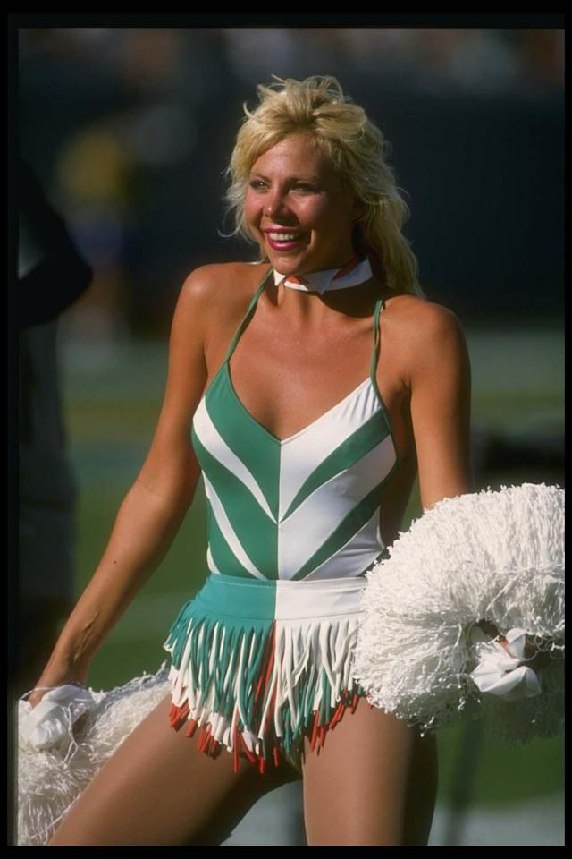 16 Oct 1988: A Miami Dolphins cheerleader looks on during a game against the San Diego Chargers at Joe Robbie Stadium in Miami, Florida. The Dolphins won the game, 31-28. Mandatory Credit: Allen Dean Steele /Allsport