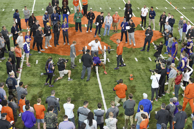 Clemson football player Tee Higgins lifts weights during NFL Pro Day Thursday, March 12, 2020, in Clemson, S.C. (AP Photo/Richard Shiro)