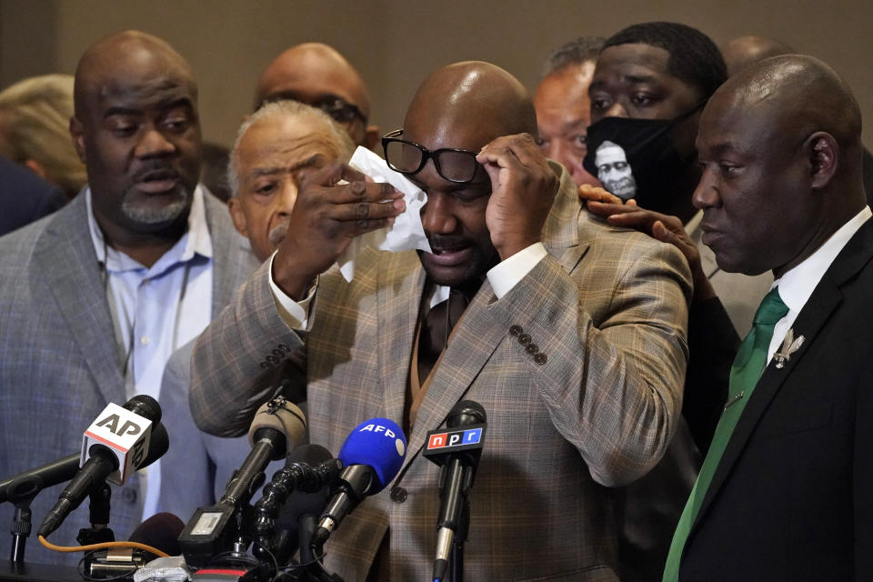 George Floyd's brother Philonise Floyd wipes his eyes during a news conference, Tuesday, April 20, 2021, in Minneapolis, after the verdict was read in the trial of former Minneapolis Police officer Derek Chauvin for the murder of George Floyd. (AP Photo/Julio Cortez)