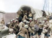 <p>Scottish soldiers, smiling, prepare to board a truck as they depart the battlefield (Royston Leonard / Media Drum World / Caters News) </p>