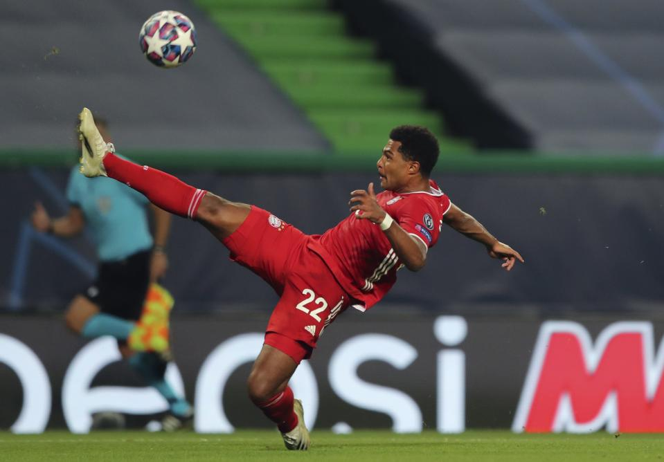 FILE - In this Wednesday, Aug. 19, 2020 file photo, Bayern's Serge Gnabry tries to control the ball during their Champions League semifinal soccer match against Lyon at the Jose Alvalade stadium in Lisbon, Portugal. New lightweight soccer boots, or cleats, featuring carbon-fiber plates have been giving players a speedy edge at the Champions League finals. Serge Gnabry has three goals in two games for Bayern Munich, and rival winger Angel Di Maria scored one and set up Paris Saint-Germain's other two goals in the semifinals. The pandemic-enforced extension to the European season meant the new boots were ready for Gnabry and Di Maria and other Adidas-backed players to wear at the Champions League mini-tournament which ends Sunday, Aug, 23 with Bayern playing PSG in the final. (Miguel A. Lopes/Pool via AP, file)