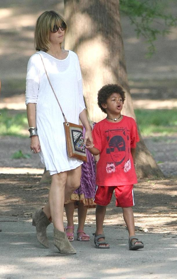 """Heidi held hands with her oldest son, Henry, during their stroll. What do you think of the supermodel's wardrobe choice? Daniel/<a href=""""http://www.infdaily.com"""" target=""""new"""">INFDaily.com</a> - June 20, 2010"""