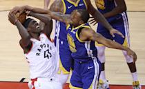 Golden State Warriors guard Andre Iguodala (9) forces a jump ball with Toronto Raptors forward Pascal Siakam (43) as the Toronto Raptors play the Golden State Warriors in game Two of the NBA Finals at Scotiabank Arena in Toronto.