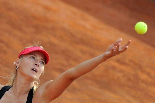 Russia's Maria Sharapova serves during her quarter-final match against American Venus Williams at the WTA Rome tournament