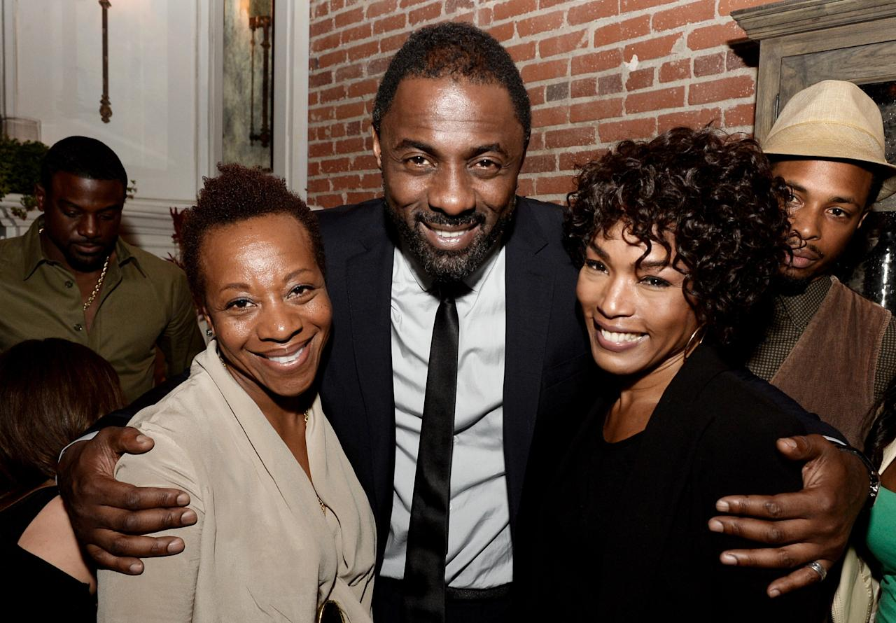 """LOS ANGELES, CA - NOVEMBER 11: (L-R) Actors Marianne Jean-Baptiste, Idris Elba and Angela Bassett pose at the after party for the premiere of The Weinstein Company's """"Mandela: Long Walk To Freedom"""" at The Warwick on November 11, 2013 in Los Angeles, California. (Photo by Kevin Winter/Getty Images)"""