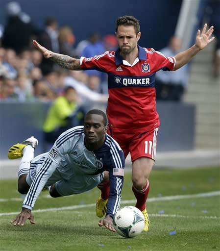 Chicago Fire midfielder Bobby Convey (11) knocks down Sporting Kansas City forward C.J. Sapong (17) during the first half of an MLS soccer match in Kansas City, Kan., Saturday, March 16, 2013. (AP Photo/Orlin Wagner)