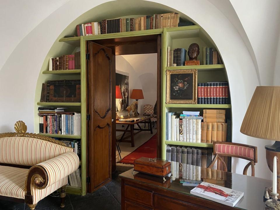 Villa Don Arcangelo all'Olmo study lined with books and mahogany desk