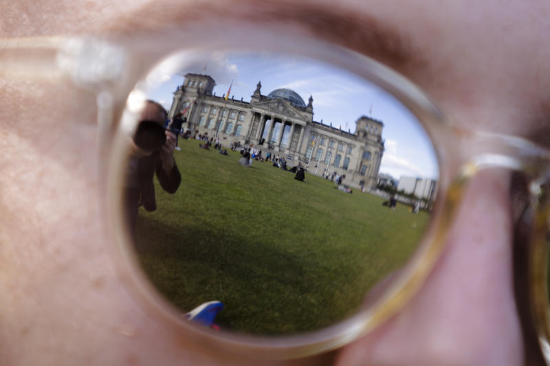 FILE - The Sept. 22, 2017 file photo shows the Reichstag building, which host the German parliament Bundestag as it is reflected in the sunglasses of a woman in Berlin. German Interior Minister Horst Seehofer will inform in a press conference on Tuesday, Jan. 8, 2019 on an alleged hacking case that saw hundreds of politicians' and celebrities' private information posted online. (AP Photo/Markus Schreiber, file)