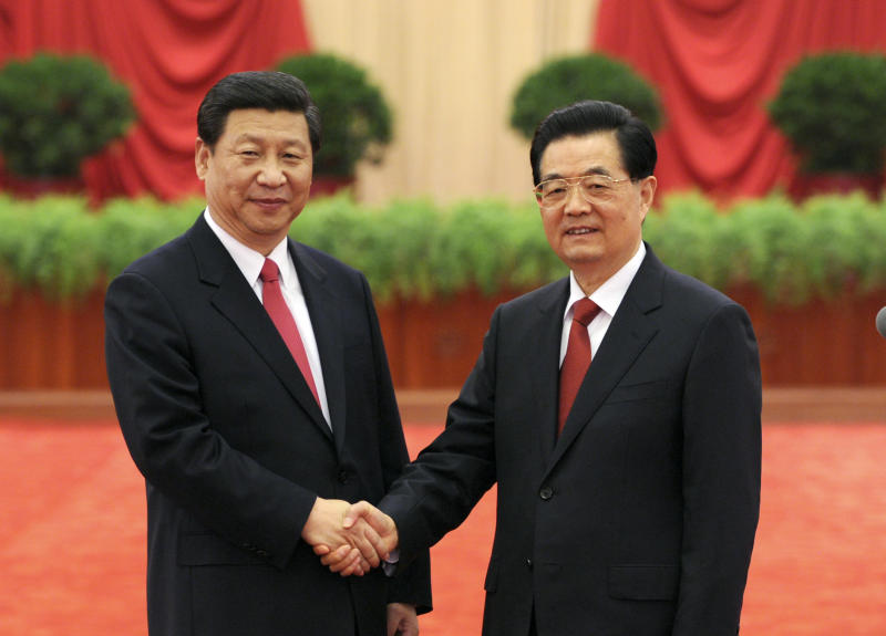 In this Nov. 15, 2012 photo released by China's Xinhua News Agency, Hu Jintao, right, shakes hands with Xi Jinping as they meet with delegates, special delegates and observers to the recently concluded 18th National Congress of the Communist Party of China (CPC), in Beijing, China. Xi succeeded Hu as China's leader Thursday, assuming the top posts in the Communist Party and the powerful military in a once-a-decade political transition unbowed by scandals, a slower economy and public demands for reforms. (AP Photo/Xinhua, Li Xueren) NO SALES