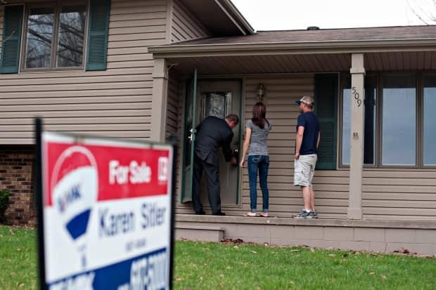 House hunters at a real-estate showing prepare to see how far their dollars can go. Buyers across the country seem unfazed by skyrocketing prices. Sales were up in March 70 per cent compared to a year ago. (Daniel Acker/Bloomberg - image credit)