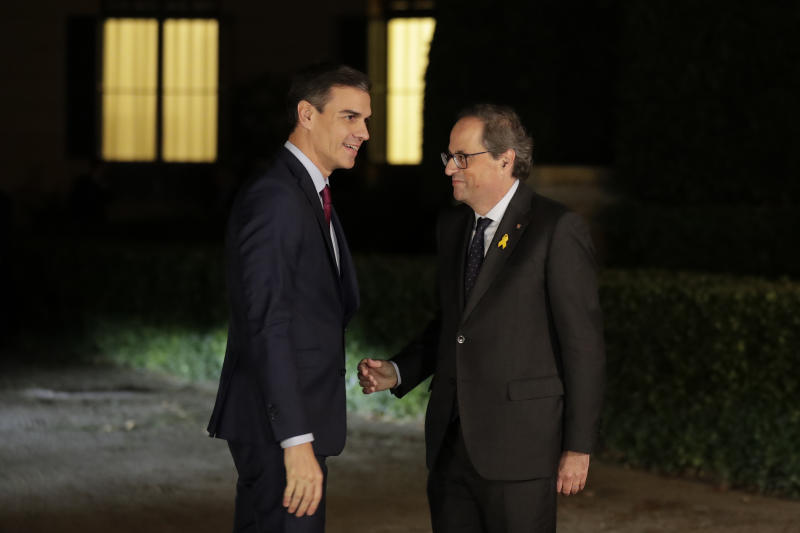 Spain's Prime Minister Pedro Sanchez, left, meets the president of the country's Catalonia region, Quim Torra in Barcelona, Spain, Thursday, Dec. 20, 2018. Prime Minister Sanchez met with Catalonia's regional President Torra, who heads a pro-secession coalition and wants self-determination to be part of the talks. (AP Photo/Manu Fernandez)