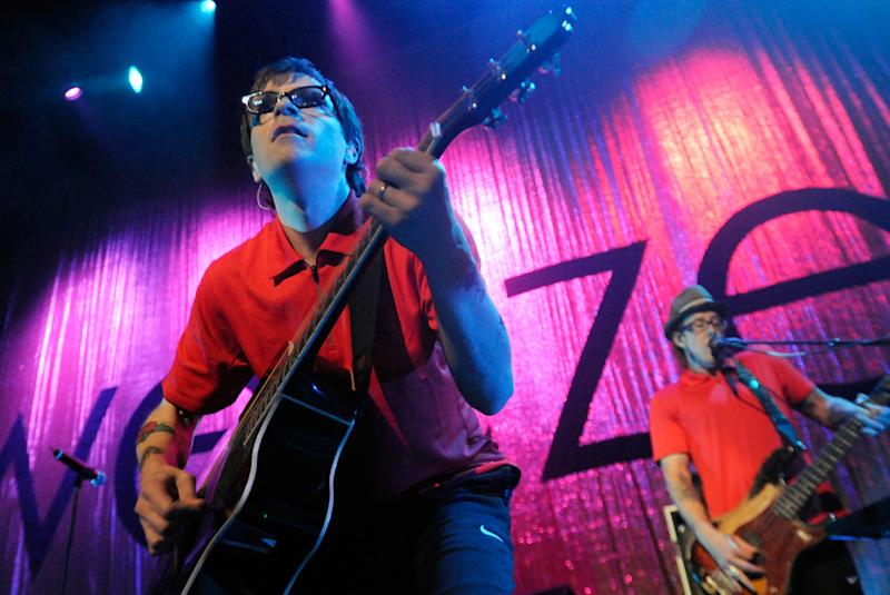 Rivers Cuomo, left, and Scott Shriner, right, of Weezer perform during the Virgin Mobile Freefest concert Sunday, Aug. 30, 2009 at Merriweather Post Pavilion in Columbia, Md.