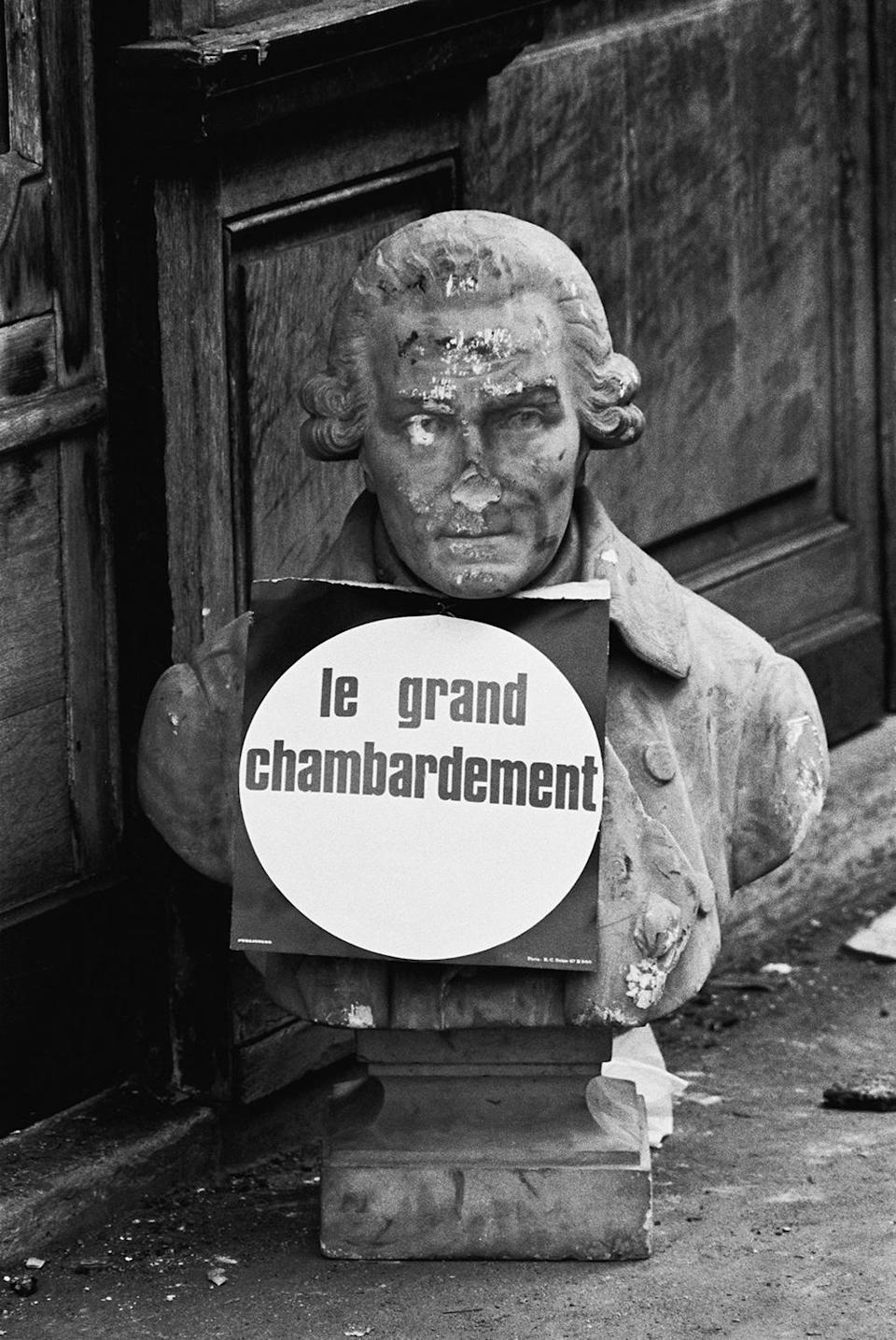 <p>A damaged bust is seen on Rue des Saints Pères after student clashes with police in the Latin Quarter of Paris on May 11, 1968. (Photo: Gökşin Sipahioğlu/SIPA) </p>