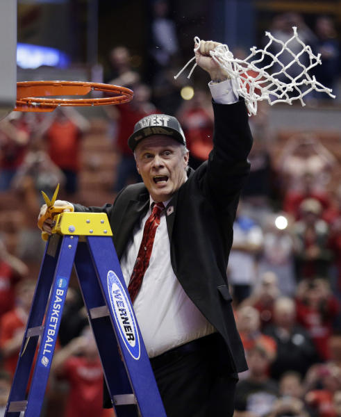 Wisconsin head coach Bo Ryan celebrates after cutting down the net after a regional final NCAA college basketball tournament game against Arizona, Saturday, March 29, 2014, in Anaheim, Calif. Wisconsin won 64-63 in overtime. (AP Photo/Jae C. Hong)