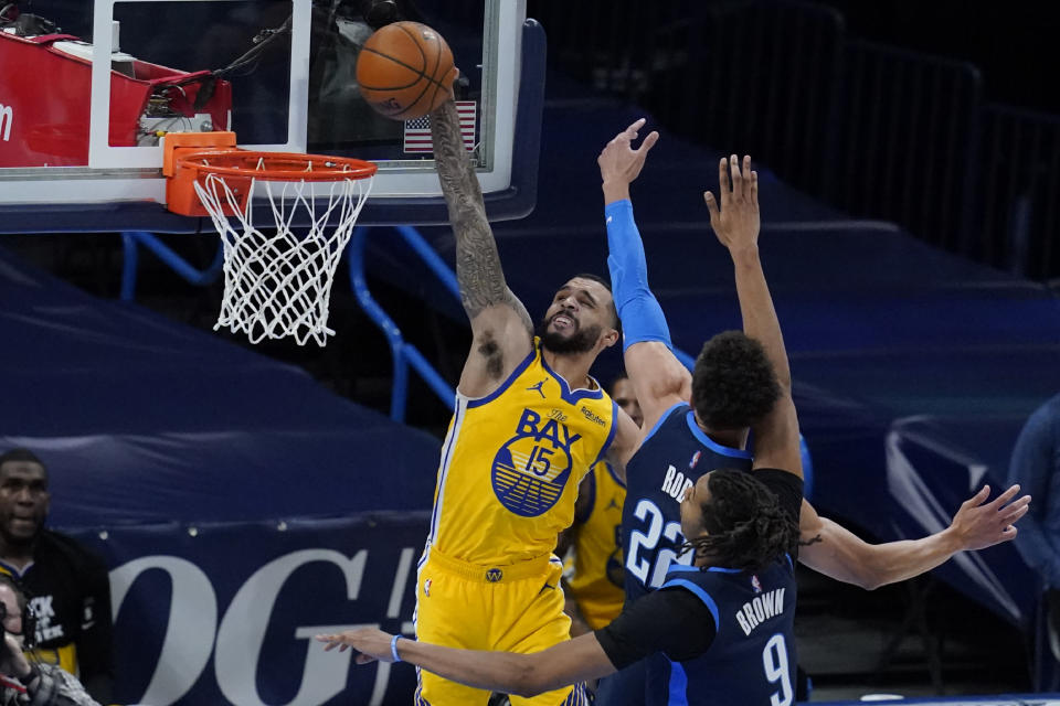 Golden State Warriors guard Mychal Mulder (15) goes up for a dunk in front of Oklahoma City Thunder center Isaiah Roby (22) and center Moses Brown (9) in the first half of an NBA basketball game Wednesday, April 14, 2021, in Oklahoma City. (AP Photo/Sue Ogrocki)