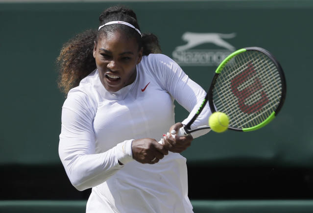 Serena Williams of the United States returns the ball to Germany's Julia Gorges during their women's singles semifinals match at the Wimbledon Tennis Championships, in London, Thursday July 12, 2018.(AP Photo/Kirsty Wigglesworth)