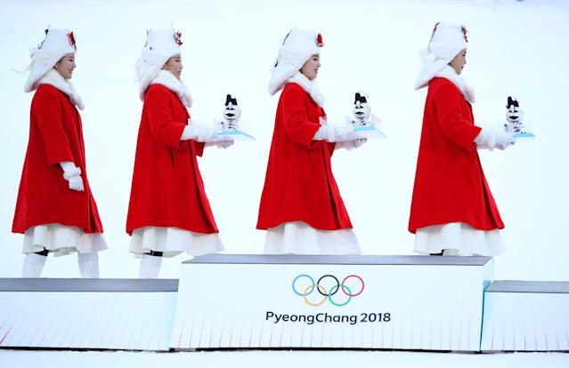 <p>The presentation party enter the arena for the Men's Alpine Combined Slalom victory ceremony on day four of the PyeongChang 2018 Winter Olympic Games at Jeongseon Alpine Centre on February 13, 2018 in Pyeongchang-gun, South Korea. (Photo by Ezra Shaw/Getty Images) </p>