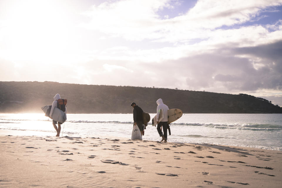 Surfers walk along the beach at Bunker Bay, 2.5 hours south of Perth in the Margaret River region of Western Australia. Source: AAP