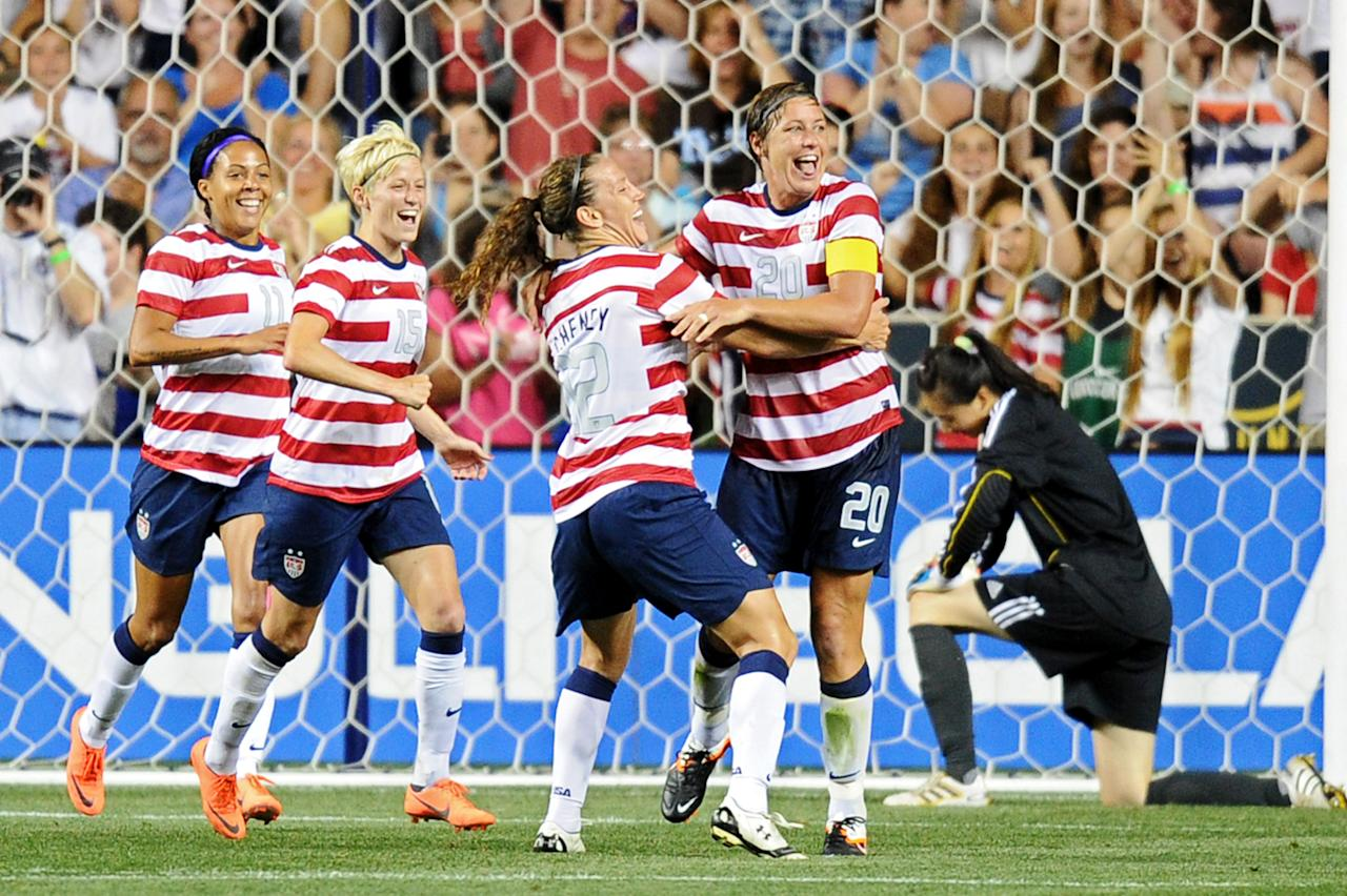 CHESTER, PA - MAY 27: Sydney Leroux #11, Megan Rapinoe #15 and Lauren Cheyney #12 of the USA congratulate teammate Abby Wambach #20 on a second half goal in front of Zhang Yue #1 of the China at PPL Park on May 27, 2012 in Chester, Pennsylvania. USA won 4-1. (Photo by Drew Hallowell/Getty Images)