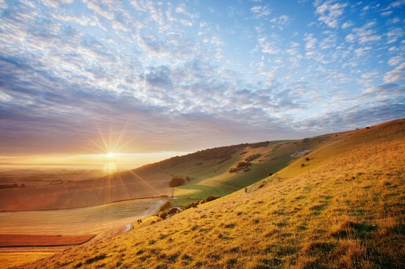 A sunrise over chalk downland viewed from Wilmington Hill in the South Downs National Park, East Sussex: Guy Edwardes/National Trust/PA Wire