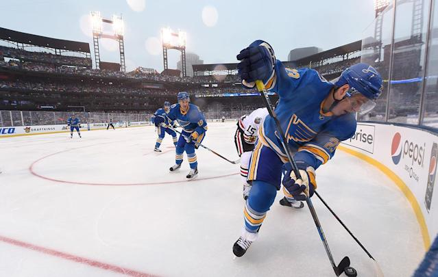 <p>ST LOUIS, MO – JANUARY 02: Dmitrij Jaskin #23 of the St. Louis Blues and Robby Fabbri #15 of the St. Louis Blues vie for the puck in the corner during the 2017 Bridgestone NHL Winter Classic at Busch Stadium on January 2, 2017 in St Louis, Missouri. (Photo by Brian Babineau/NHLI via Getty Images) </p>